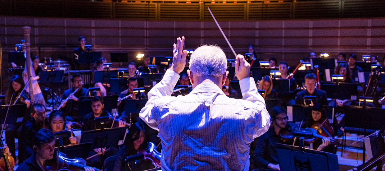 Conductor directs the orchestra at the University of Miami